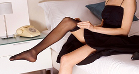 crossdresser putting on stockings
